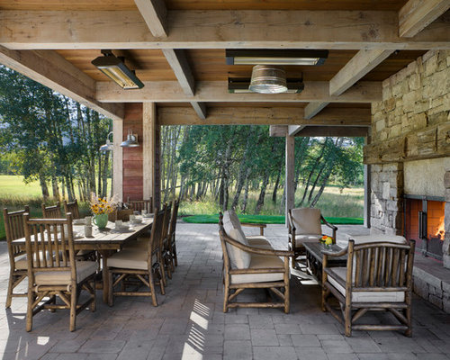 Inspiration For A Farmhouse Patio Remodel In Other With A Fire Pit And A  Roof Extension