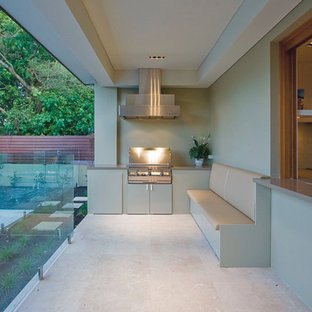 This is an example of a contemporary patio in Sydney with a roof extension.