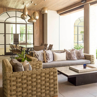 Inspiration for a transitional patio remodel in Dallas with a roof extension