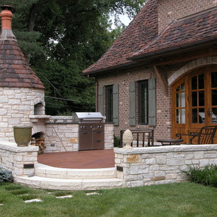 This is an example of a traditional patio in St Louis with a fire feature and no cover.
