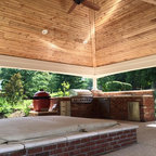Covered Porch With Aluminum Spring Lounge Chairs And