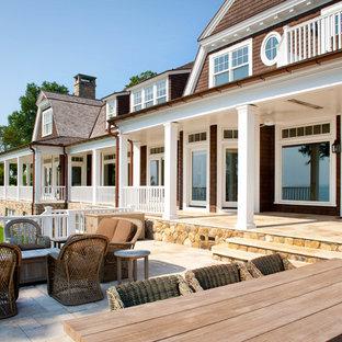 Esempio di un patio o portico vittoriano con nessuna copertura