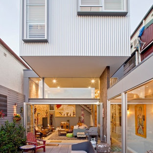 Design ideas for a contemporary backyard patio in Sydney with concrete pavers and no cover.