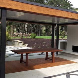 Large Minimalist Backyard Tile Patio Photo In Auckland With A Fire Pit And  A Pergola