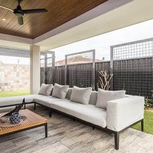 Photo of a contemporary patio in Perth with tile and a roof extension.