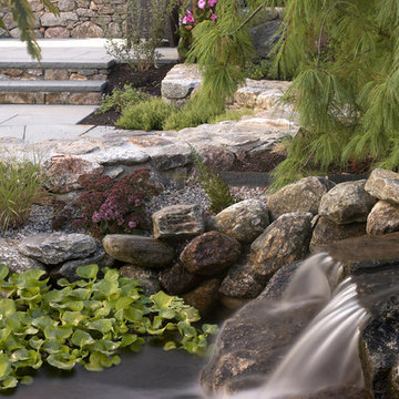 Stone patio and waterfall
