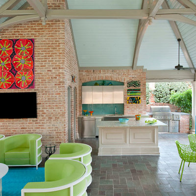 Large transitional backyard tile patio photo in Dallas with a gazebo