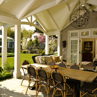 Example of a classic patio design in San Francisco with a roof extension