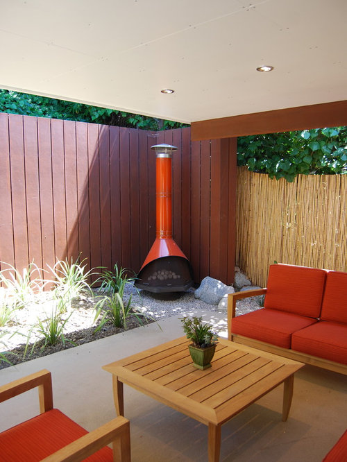 Danish Modern Fireplace Part - 24: Minimalist Patio Photo In Los Angeles With A Fire Pit