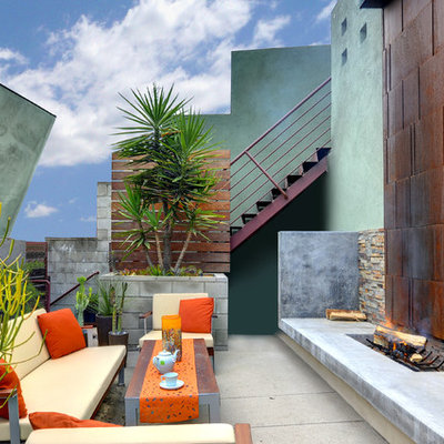 Trendy concrete patio photo in Los Angeles with no cover