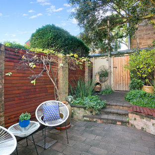 This is an example of a contemporary backyard patio in Sydney with brick pavers and no cover.