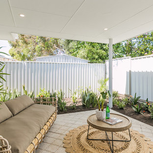 Photo of a small contemporary backyard patio in Perth with concrete pavers and a roof extension.