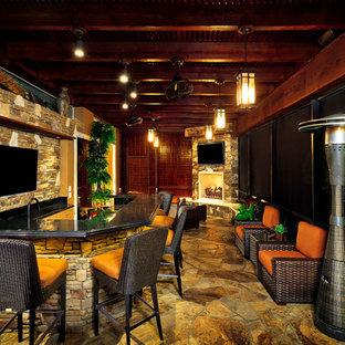 Пример оригинального дизайна: дворик в средиземноморском стиле с летней кухней