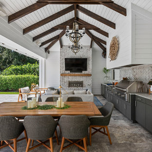 Patio kitchen - coastal patio kitchen idea in Orlando with a roof extension