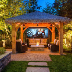 tropical patio by Cedar Springs Landscape Group