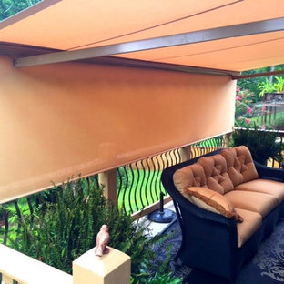 This is an example of a medium sized back patio in Other with an awning.