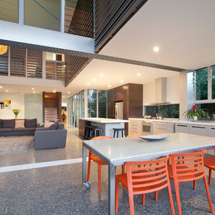 Inspiration for a large contemporary backyard patio in Gold Coast - Tweed with an outdoor kitchen.