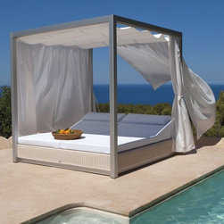 Outdoor Daybed - This outdoor daybed with side and overhead curtains provides both shade and privacy.