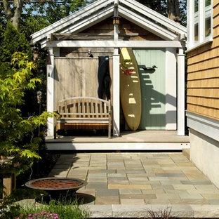 Foto di un patio o portico bohémian di medie dimensioni e nel cortile laterale con nessuna copertura e pavimentazioni in pietra naturale