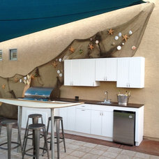 Beach Style Patio by Green Planet Landscaping Pools & Spa