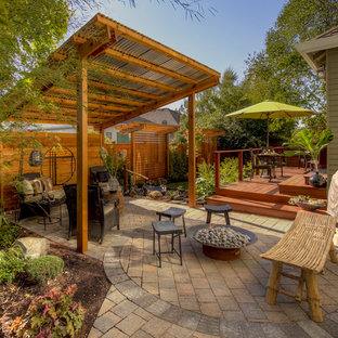 Inspiration for a timeless brick patio remodel in Portland with a fire pit