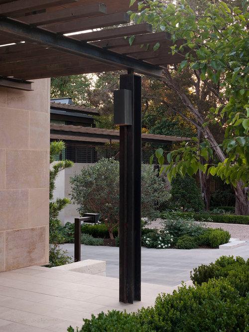 Mid Sized Minimalist Backyard Stone Patio Photo In Austin With A Pergola
