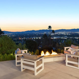 Large trendy backyard concrete patio photo in Los Angeles with a fire pit and no cover