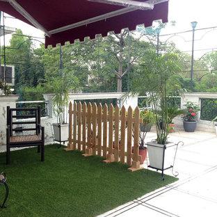 Inspiration for a contemporary patio remodel in Delhi