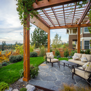 Patio - traditional backyard patio idea in Seattle with a pergola