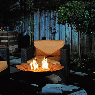 Mid-sized backyard concrete paver patio photo in Sacramento with a fire pit and a pergola