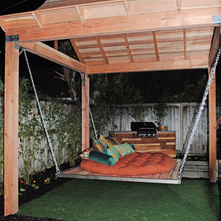 Inspiration for a mid-sized asian backyard concrete paver patio remodel in Sacramento with a fire pit and a pergola
