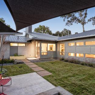 Patio - 1960s backyard concrete patio idea in Houston