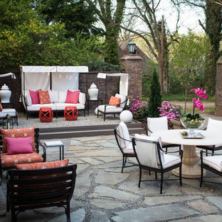 Inspiration for a transitional stone patio remodel in Raleigh with no cover