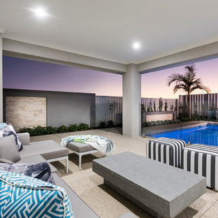 Large contemporary backyard patio in Perth with a roof extension.