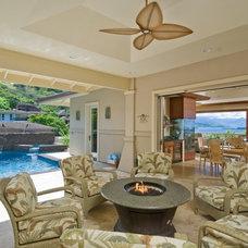 Tropical Patio by Archipelago Hawaii Luxury Home Designs