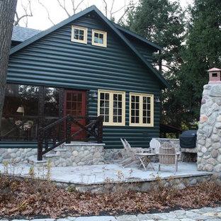 Esempio di un patio o portico stile rurale con pavimentazioni in pietra naturale e nessuna copertura