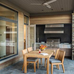 modern outdoor kitchen mediterranean example of midsized minimalist backyard stone patio kitchen design in other with 75 most popular modern outdoor kitchen design ideas photos houzz