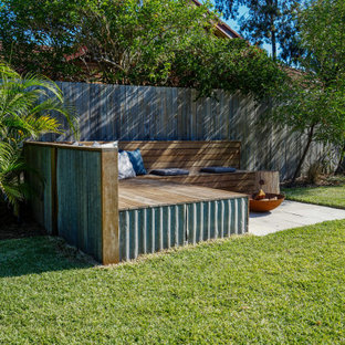 Design ideas for a contemporary patio in Sydney with a fire feature and no cover.
