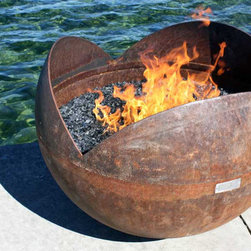 The Firefly 37 inch Sculptural Firebowl - The Firefly is a deep, large bowl that shields fire from wind within its three petals while providing an inviting space to gaze into the fire. Joining the cut off from the King Isosceles to the form of a Big Bowl O' Zen, the Firefly resembles a large flower bud or seed pod.