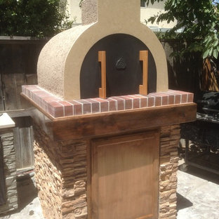Inspiration for a small classic back patio in San Francisco with an outdoor kitchen and no cover.