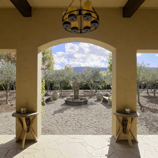 Mediterranean Patio by Neal A. Pann, Architect
