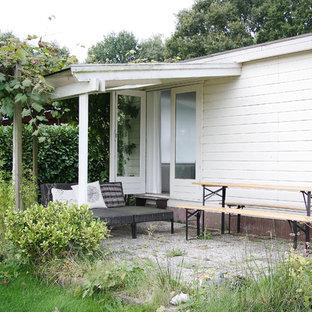 Esempio di un piccolo patio o portico scandinavo