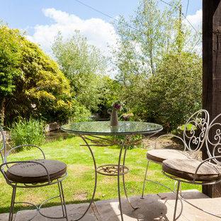Patio - shabby-chic style patio idea in London