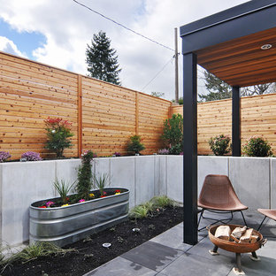 Example Of A Small Trendy Backyard Concrete Paver Patio Container Garden  Design In Seattle With A