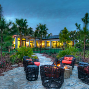 Patio - traditional backyard patio idea in Tampa with a fire pit and no cover