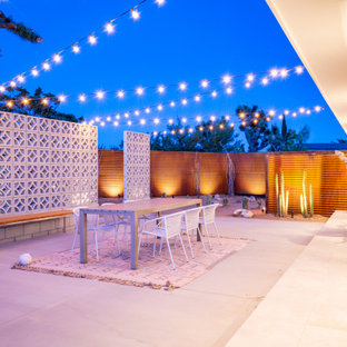 Inspiration for a mid-sized southwestern backyard concrete patio remodel in Other with no cover and a fire pit
