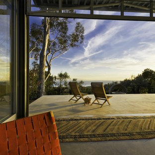 Trendy concrete patio photo in Santa Barbara with a roof extension