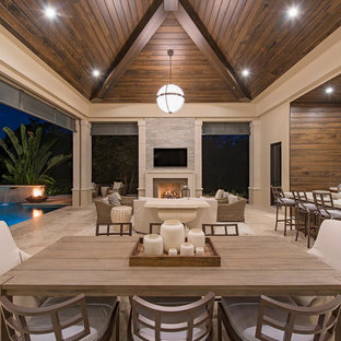 Example of a huge transitional backyard patio kitchen design in Miami with a roof extension