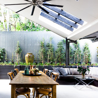 Photo of a contemporary backyard patio in Brisbane with concrete pavers.