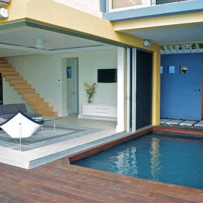 Inspiration for a contemporary patio remodel in Miami with decking and no cover